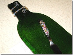 Slumped textured wine bottle with glass beaded knife